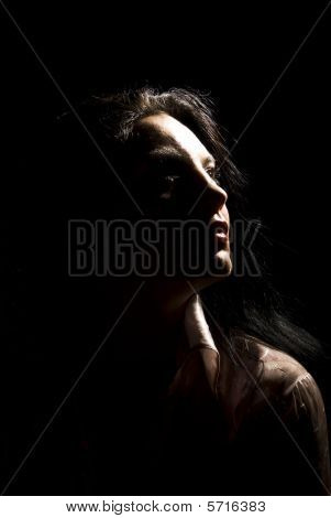 Portrait Of Woman In Dark With Soft Light