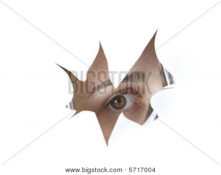 Eye Peeking Through A Hole