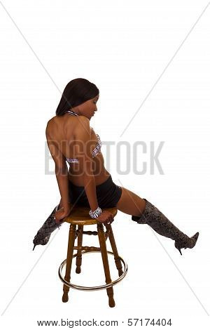 Black Woman Sitting On Stool Back Boots