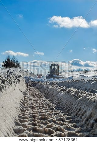 truck cleaning road in winter
