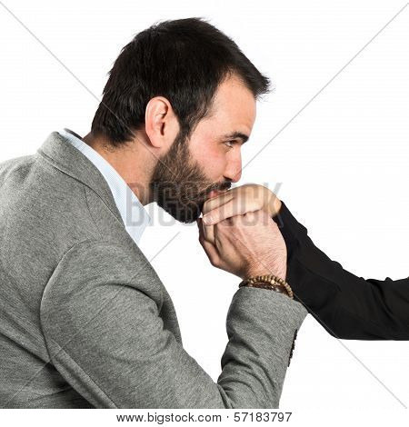 Man Kissing A Woman's Hand Over White Background.