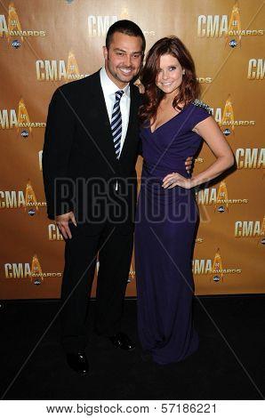 Nick Swisher and Joanna Garcia at the 44th Annual CMA Awards, Bridgestone Arena, Nashville, TN.  11-10-10
