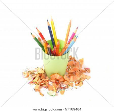 Cup With Colorful Pencils And Chips