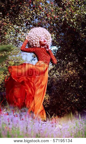 Creativity. Ultramodern Woman Blond In Artificial Huge Futuristic Wig Outside