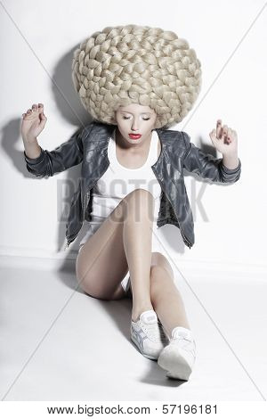 Extravagance. Eccentric Blonde Hair Model With Fantastic Updo Coiffure