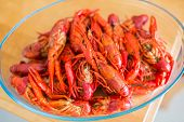 picture of crawfish  - Red boiled crawfish in clear glass bowl - JPG