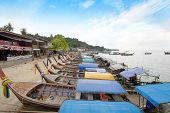 stock photo of phi phi  - Long Tail Boat at Phi Phi Island Thailand traditional longtailboat brings tourists to the islands in Krabi - JPG
