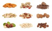 stock photo of groundnut  - Piles of different nuts  - JPG