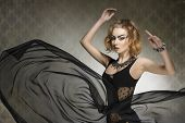 stock photo of up-skirt  - bizarre portrait of fashion sensual woman with gothic style strong make - JPG