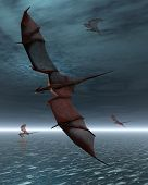 stock photo of moonlit  - A flight of four red dragons over a calm moonlit sea - JPG