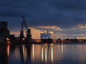 foto of nightfall  - A ship carrying cars berthed at the port of Gdansk Poland.