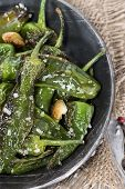 stock photo of pimiento  - Portion of fres made Pimientos de Padron - JPG