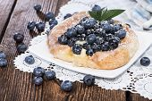 foto of tarts  - Blueberry Tart on a plate (vintage wooden background)