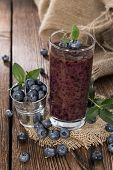 stock photo of smoothies  - Fresh made Blueberry Smoothie on wooden background - JPG