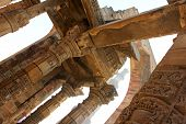 picture of qutub minar  - qutub minar with carved wall and pillars - JPG