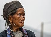 Close Up Of Hmong Elderly Woman Against Gray Skies.