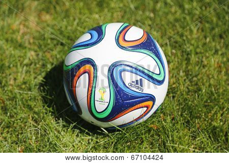 Brazuca soccer ball on grass