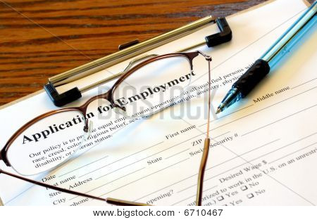 Employment application and glasses
