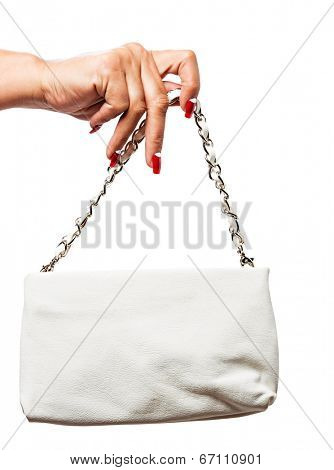 closeup of the woman�?�¢??s hand wearing red half moon nail art manicure with white leather bag with silver chain bag, isolated on white studio background