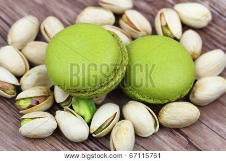Pistachio macaroons on pistachio nuts