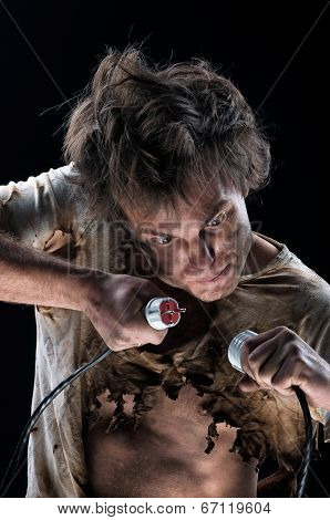 Portrait of funny electrician over black background