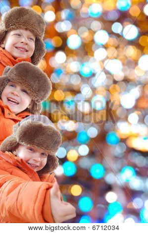 Happy Winter Kids Against Colorful Lights