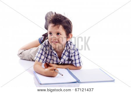 Schoolboy drawing with pencil, isolated on white background