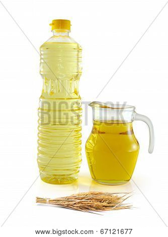 Rice Bran Oil In Bottle Glass With Seed And Bran On White Background