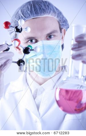 Young Scientist witch Atoms and Flask