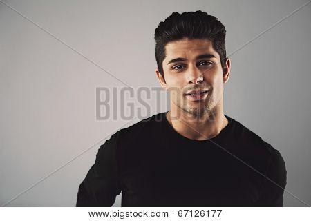 Young Man In Casual T-shirt Looking At Camera