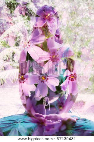 Double exposure portrait of meditating woman blended with image of pink flowers