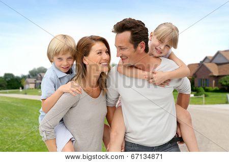 Parents and children standing in neighborhood