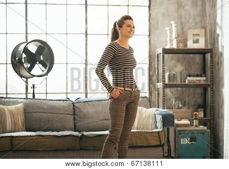 Young Woman Standing In Loft Apartment