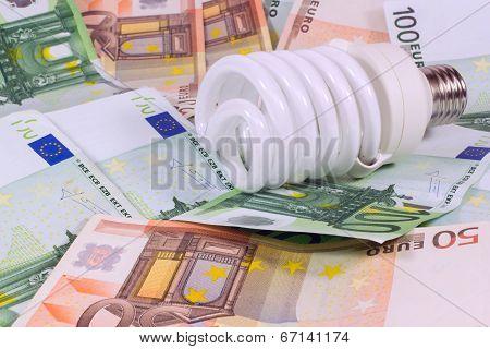 Saving Money Saving Bulb.lightbulb On Money Euro Background