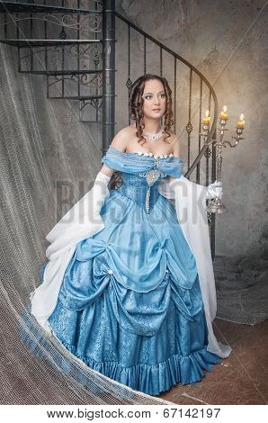 Beautiful Woman In Medieval Dress With Candelabrum