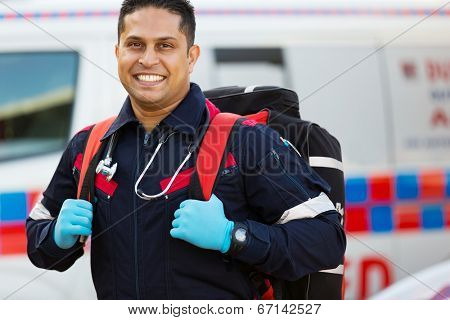 happy emergency medical service staff carrying equipment