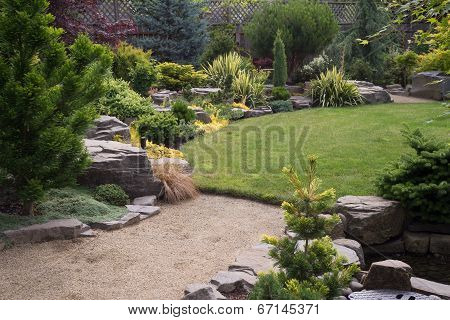 Path To Backyard With Rocks And Lawn