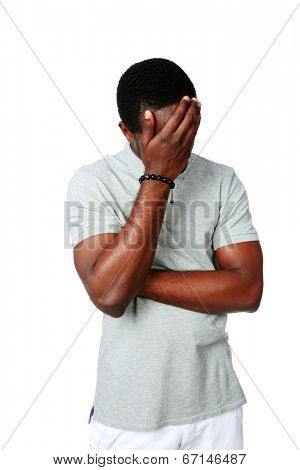 Portrait of a upset african man isolated on white background