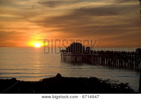 Beautiful ocean sunset with pier