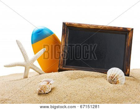 Sunblock And A Blackboard On The Sea Sand