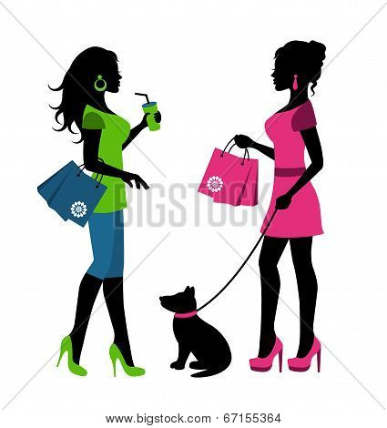 Two women with bags and a dog on a leash