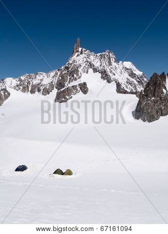 Mountain Base Camp: the tents of a group of mountaineers that aim to conquest the Dent du Geant peak. Chamonix, France, Europe.