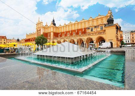 Cloth Hall on Rynek Glowny and fountain in Krakow
