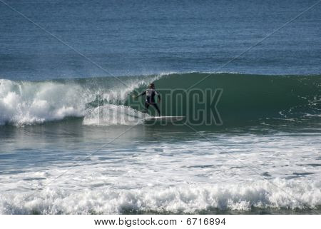 A surfer catches the waves