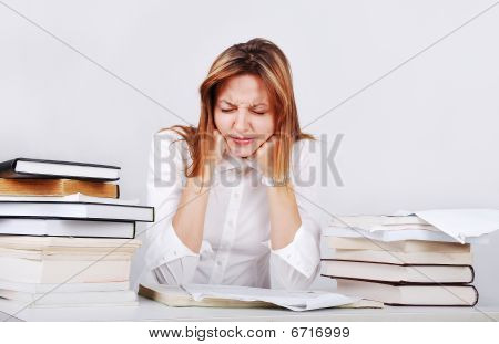 Young Female Model Sitting On Desk With Many Books