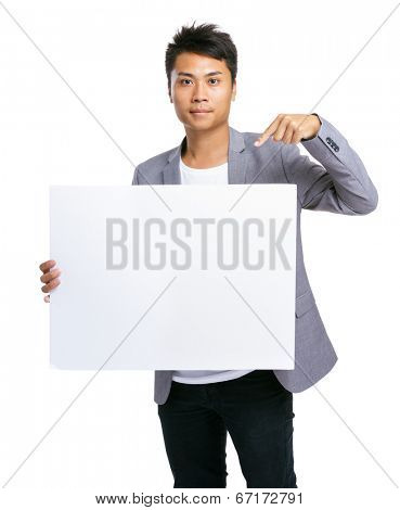 Business man finger point to blank board