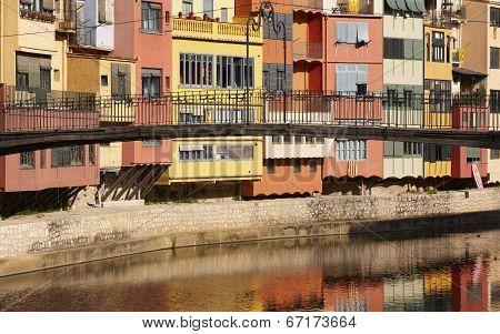 Spain. Catalonia. Girona. Onar Colorful Houses And Bridge.