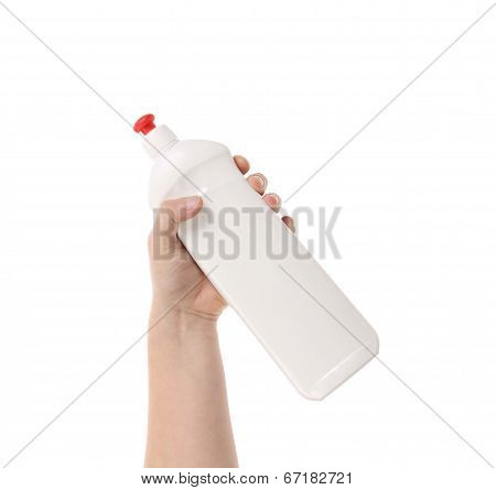 Plastic bottle with dish soap.