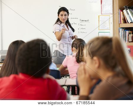 Teacher telling off children in class