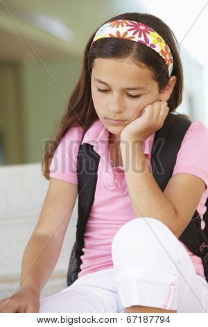 Unhappy Pre teen girl at school